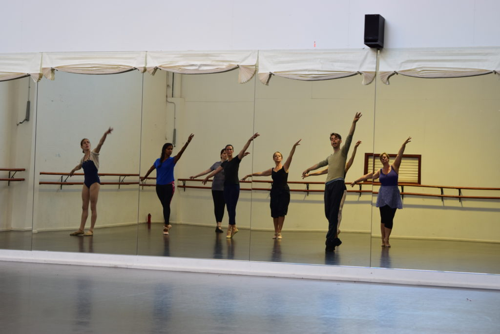 Adult Ballet Dancers dancing in Centre Practice at City Adult Ballet looking at their reflection in the mirror