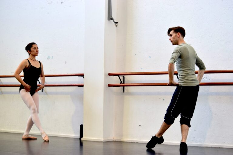 Dancer receiving ballet corrections from teacher Kyle Davey